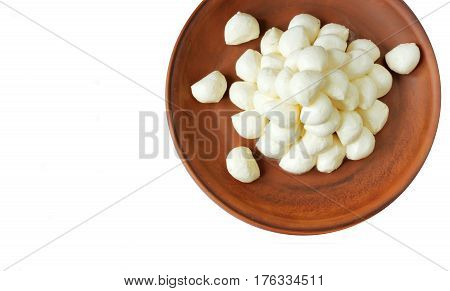 Mozzarella baby on plate isolated on white background top view blank space for text