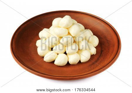 Mozzarella baby pyramid on a plate isolated on white