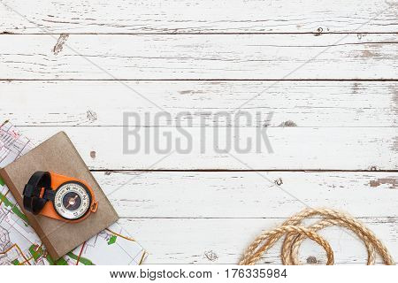 empty white wooden table with tools for expedition, top view