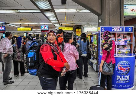 Bali,Indonesia-May 27,2010: People waiting in queue at arrival immigration of Bali Ngurah Rai International Airport Bali,Indonesia.Its also known as Denpasar International Airport & It is Indonesia's third-busiest international airport.