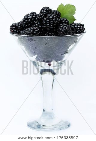 Blackberries in a glass isolated on white