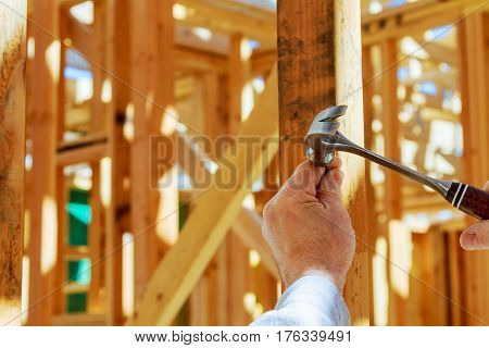 Builder Worker Nailing With Hammer Construction