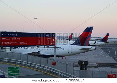 NEW YORK - MAY 22, 2015: Delta Airlines planes on tarmac at JFK International Airport. JFK is one of the biggest airports in the world with 4 runways and 8 terminals
