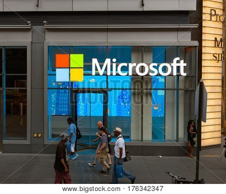 Edestrians Walk Past The Offices Of Microsoft In Nyc