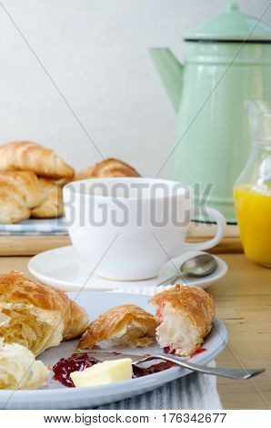 Continental Breakfast Setting On Light Wood Table