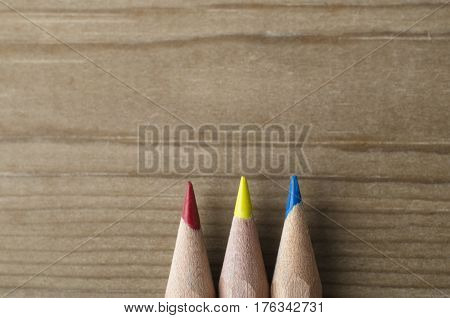 Row Of Three Pencils In Red, Yellow And Blue