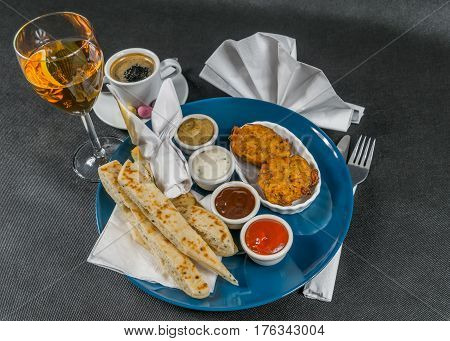 Oriental Indian Set,  Naan Bread And Onion Bhaji, Four Sauces, Blue Plate, Black Coffee, White Wine