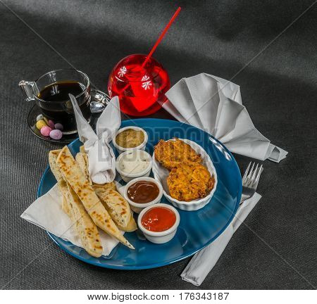 Oriental Indian Set,  Naan Bread And Onion Bhaji, Four Sauces, Blue Plate, Black Coffee, Drink