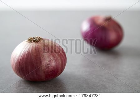 Red Onions On Gray Granite Slab