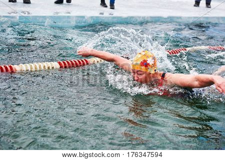 Sahyurta ,irkutsk Region, Russia - March 11.2017: Cup Of Baikal. Winter Swimming. Butterfly. Woman
