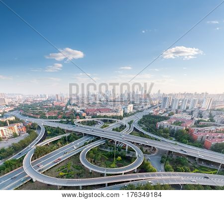 city highway interchange with blue sky aerial view of modern traffic background