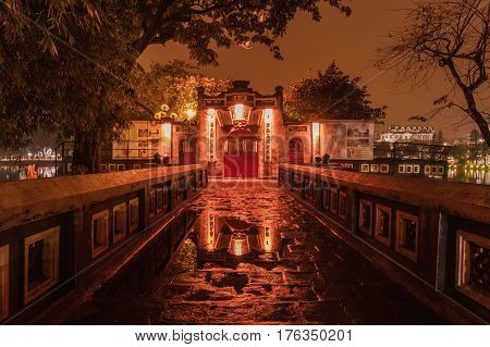 HANOI VIETNAM - March 08 2017: Entry to Red Bridge- The Huc Bridge in Hoan Kiem Lake Hanoi Vietnam. Night view. This is a lake in the historical center of Hanoi the capital city of Vietnam