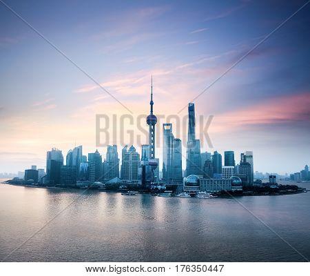 shanghai skyline with huangpu river in sunrise