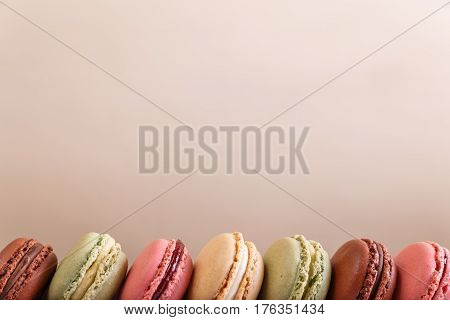 Macaroon cakes. Different types of macaron. Colorful almond cookies. French sweet dessert.