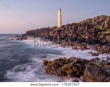 Ninini Point Lighthouse on Nawiliwili Bay in  Kaua'i' Hawai'i overlooking the ocean.