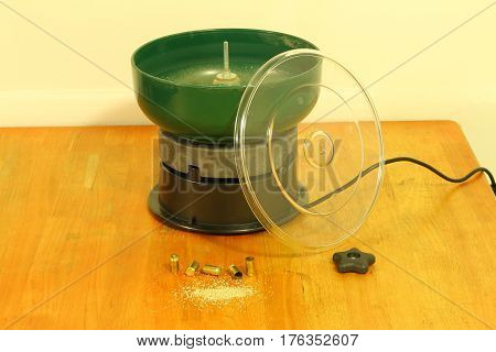 Image of reloading tumbler on wood table