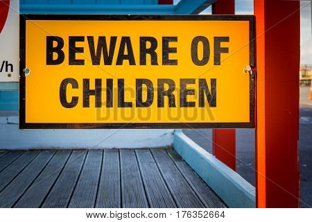 beware of children yellow attention road sign