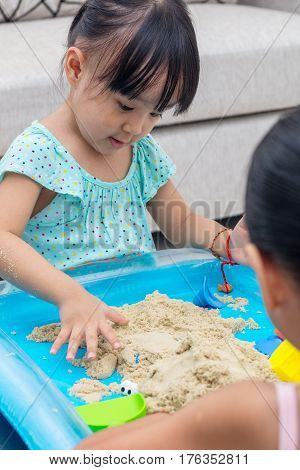 Asian Chinese Little Girl Playing Kinetic Sand At Home
