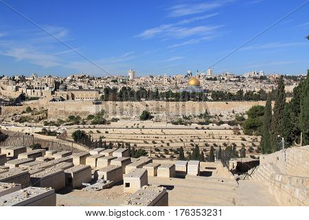 Panoramic view of Old Jerusalem including the Dome of the Rock, al-Aqsa Mosque and Cemetery on the Mount of Olives along the Kidron Valley.