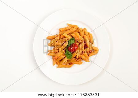 Overhead shot of Penne Ala Vodka on a white dinner plate against a white background