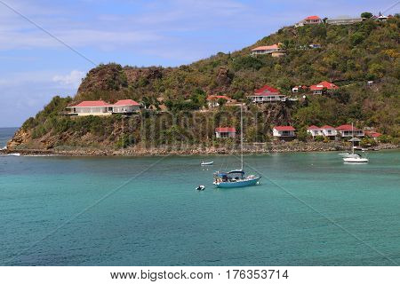 ST BARTS, FRENCH WEST INDIES - JUNE 11, 2015: Expensive villas and boats at St. Jean Bay at St Barts. The island is popular tourist destination during the winter holiday season