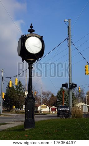 MANCELONA, MICHIGAN / UNITED STATES - NOVEMBER 27, 2016: The municipal clock provides the time in in downtown Mancelona.