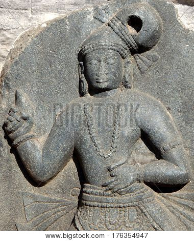 Stone carving ruins of an woman traditional dancer at an ancient Hindu Temple In Andhra Pradesh,India