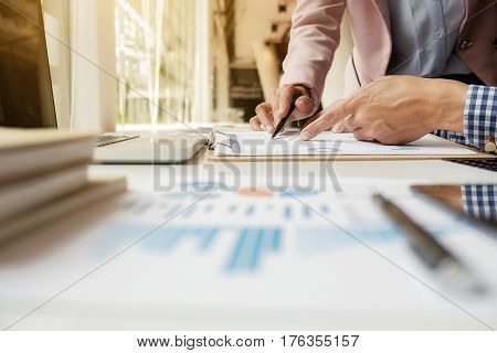 Sales team discussion process.Business crew working with new startup project.Notebooktablet wood tableusing devices.Creative Idea presentation.Analyze market stock.Blurred backgroundfilm effect