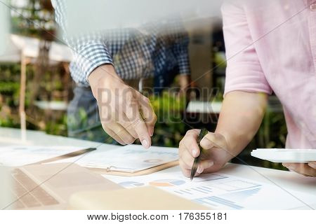 Sales team discussion process.Business crew working with new startup project.Notebook tablet wood table using devices.Creative Idea presentation.Analyze market stock.Blurred background film effect