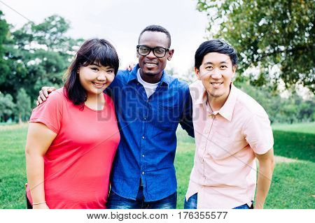 Group Of Young Multi Racial Friends Standing And Smiling Together - Multi-race Friendship Concept
