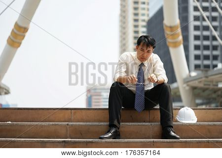 Tired Or Stressful Businessman Sit On The Stairs After Working