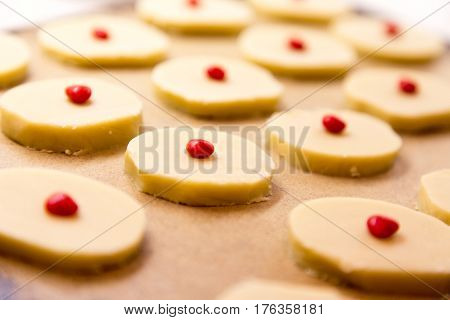 rows of hand made shortbread cookies on a stone baking sheet