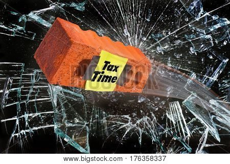 It's tax time with brick breaking glass window.