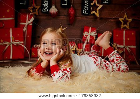 Beautiful child in anticipation of the new year.
