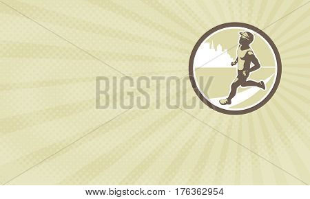Business card showing Illustration of triathlete marathon runner running facing side view with buildings in background set inside circle done in retro style.