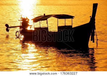 Silhouetted Longtail Boat At Sunrise On Ao Ton Sai, Phi Phi Don Island, Krabi Province, Thailand