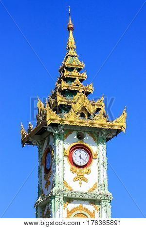 Close view of Clock tower at Mahamuni Pagoda complex in Mandalay Myanmar. Mahamuni Pagoda is a Buddhist temple and major pilgrimage site in Myanmar.