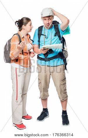 Young Couple Can Not Agree On The Travel Route On A White Background