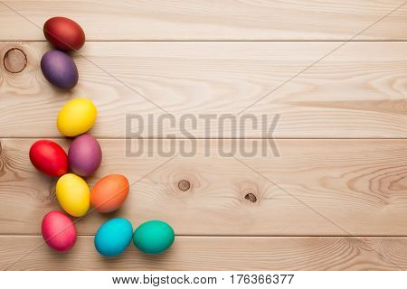 Wooden Boards And A Bunch Of Colorful Easter Eggs In The Left Corner