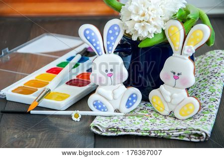 Decorated Easter Bunny Cookies Hiacinth In A Jar Paints And Brushes On A Wooden Background. Easter C