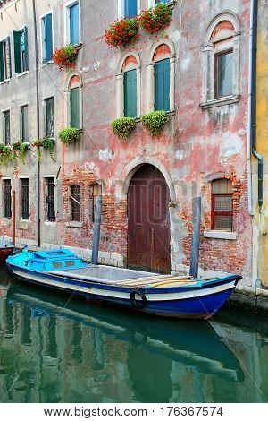 Boat Moored In A Narrow Canal In Venice, Italy