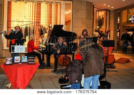Munich,Germany-October 23,2009: A group of street musicians play in the evening at Munichs Marienplatz square