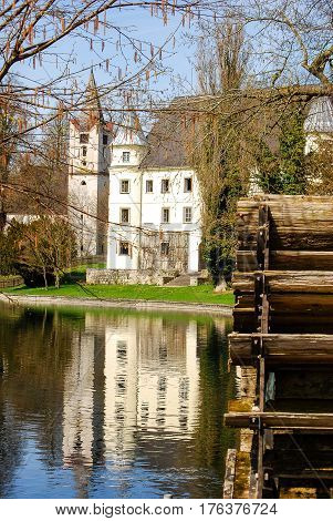Braunau,Austria- April 32010: Water reflects the front of Schloss Almegg Palace in Braunau Austria in spring