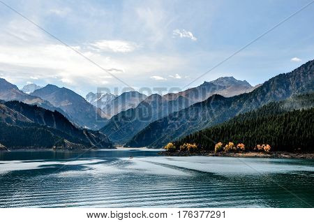 Beautiful Tianshan and Tianchi( heavenly Mountain and Lake) in Xinjiang, China.Tianchi Lake \'s elevation is 1980 meters, 3.5 kilometers long from north to south, the deepest place of the lake is 103 meters.