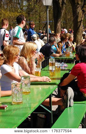 Munich,Germany- April 2,2011: People sit in a beergarden in a park in MunichGermany