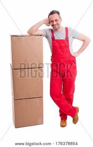 Full Body Of Smiling Mover Guy Leaning On Boxes