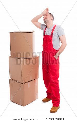 Full Body Of Tired Mover Guy Standing Near Boxes