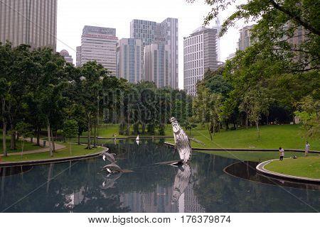 Kuala Lumpur Malaysia - November 5 2014: Pond in in the KLCC Park in Kuala Lumpur Malaysia. This city park was designed by Brazilian architect Roberto Burle Marx.