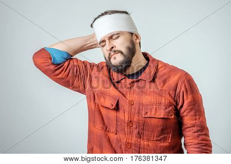 Portrait Of Man With Bandage