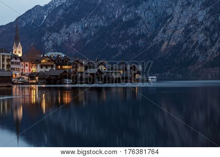 Hallstatt, Austria. Scenic view of  the landscape of the mountains and the famous Austrian Village at night.